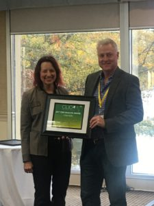Lisa Presents Chip Coyle with a Beacon Award